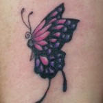 Butterfly tattoo, as shown in carousel slideshow